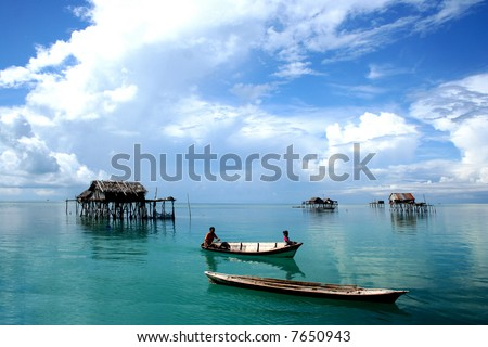 Tropical fishing village and the boat people