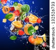Tropical fruits in water splash - stock photo