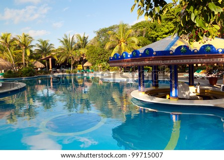 Tropical resort at swimming pool in Mexico