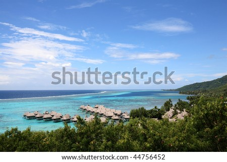 tropical resort on a turquoise blue lagoon