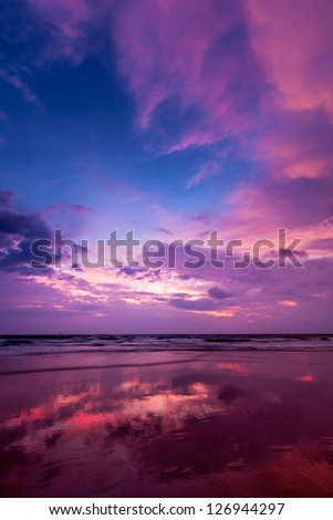 Tropical vacation holidays concept background - sunset on ocean beach. Baga, Goa, India