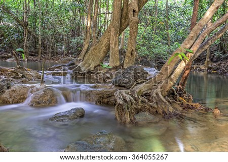 tropical waterfall in deep forest of Kanchanaburi province, Thailand.