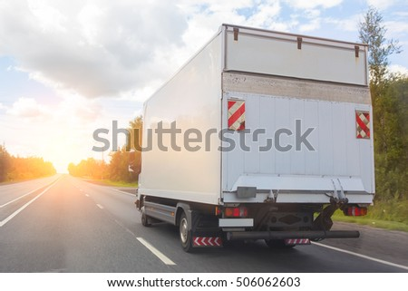 truck goes on the highway to sunrise