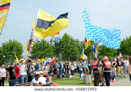 TRZEBNICA, POLAND - JULY 25: World Youth Day, crowd of pilgrims wave flags in front of St. Jadwiga Sanctuary on 25th July 2016 in Trzebnica.