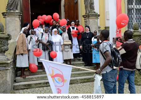 TRZEBNICA, POLAND - JULY 25: World Youth Day, Polish and Senegal nuns take photo together in front of St. Jadwiga Sanctuary on 25th July 2016 in Trzebnica.
