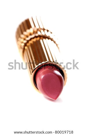 Tube of lipstick close up on a white background.