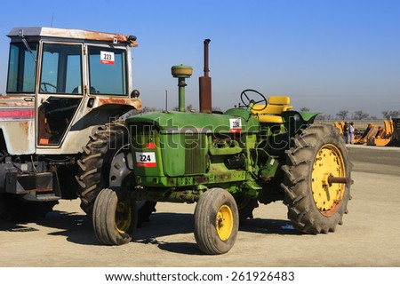 Tulare, CA, USA - February 11, 2011: Old farm tractors wait at an agricultural equipment auction in California.