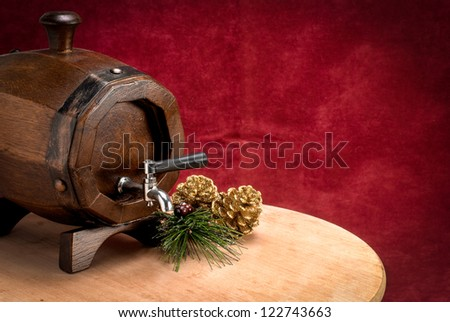 Tun With Wooden Table On Red Velvet Background With Christmas Ornament