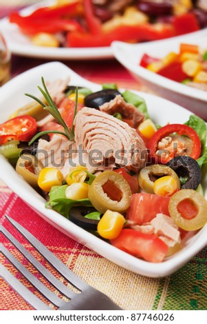 Tuna salad with olives, tomato, corn and lettuce