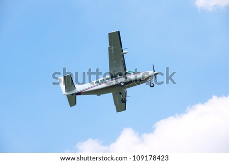 Turboprop airplane taking off in blue sky