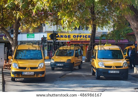 TURKEY, ALANYA - NOVEMBER 10, 2013: Parking city yellow taxi in Alanya. Is a beach resort city and a component district of Antalya Province on the southern coast of Turkey, Mediterranean Region.