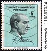 TURKEY - CIRCA 1965: A stamp printed in Turkey shows Kemal Ataturk and signature, circa 1965. - stock photo