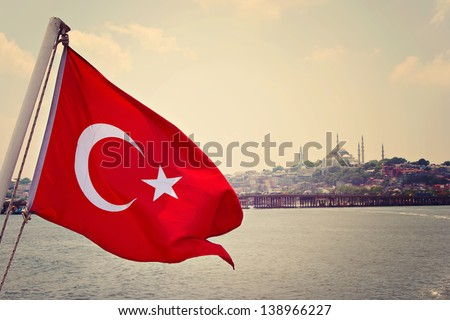 Turkey flag in Bosphorus and Sultanahmed Camii, Blue Mosque, Istanbul, Turkey