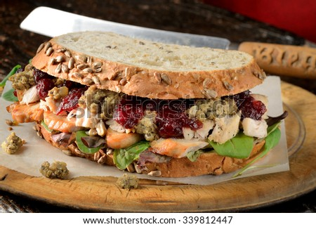 Turkey sandwich with stuffing and cranberry sauce. Freshly made from Christmas turkey leftovers on crusty wholemeal bread.