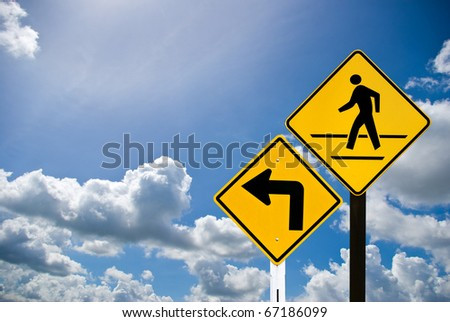 Turn left sign and a man walking sign with cloudy sky