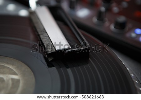 Turntable dj record player and cleaning brush to remove dust from vinyl records.Analog sound technology for DJ play music.Close up,macro of disc jockey equipment for professional studio,concert,event
