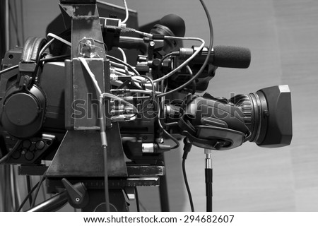 tv camera in a concert hal. Professional digital video camera. black and white photo