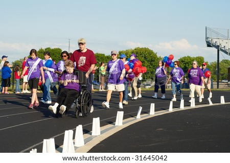 TWINSBURG, OH - June 5: Cancer survivors walk the first lap of Relay for Life, an annual fundraising event sponsored by the American Cancer Society, June 5, 2009, in Twinsburg, Ohio.