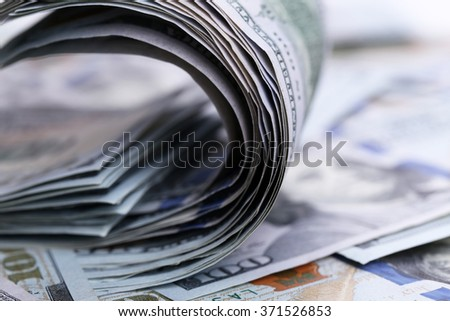Twisted dollar banknotes, close up