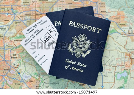 Two airplane boarding passes and two American passports, over map, selective focus