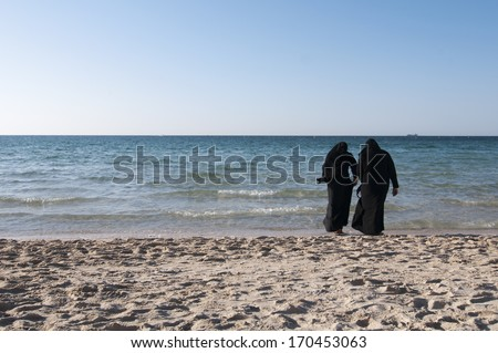 Two arab women on the beach ready to swimming