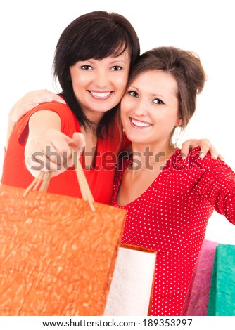 two attractive girl after shopping holding shopping bags, white backgound