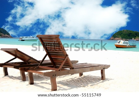 Two beach chairs on perfect tropical white sand
