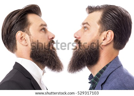 Two bearded  men standing face to face isolated on white background
