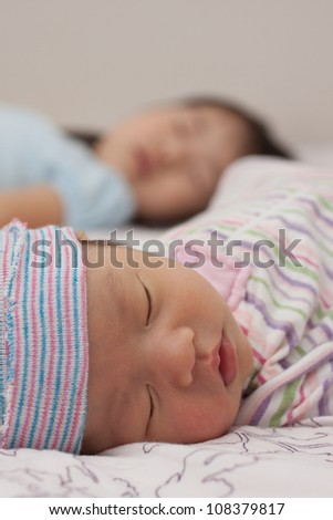 Two Beautiful Baby Asian Infant Girls