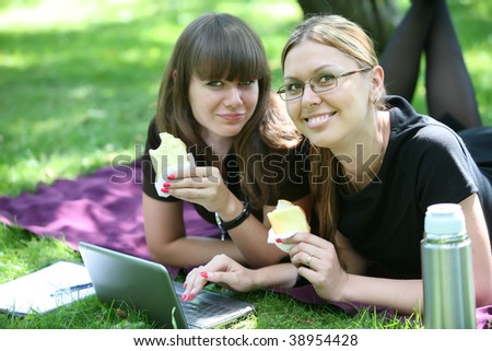 two beautiful businesswoman lunch on the open air in park