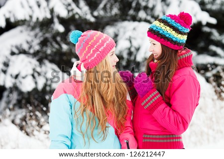 Two Beautiful Girls in winter outdoors