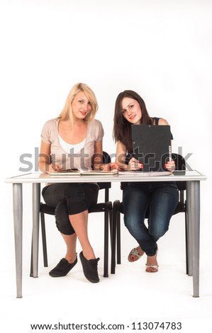 Two beautiful student girls getting ready for school isolated