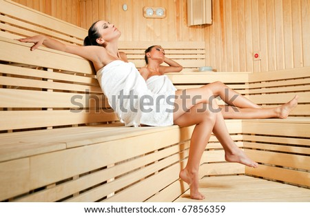 Beautiful Young Females Relaxing Wooden Spa Stock Photo