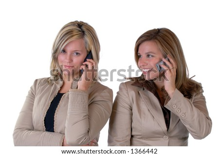 Two Beautiful Young Women Talking On A Cell Phone, Isolated