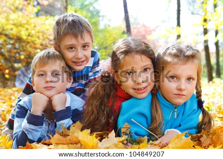 Two boys and two girls in autumn park