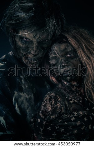 Two burnt zombie hug.
