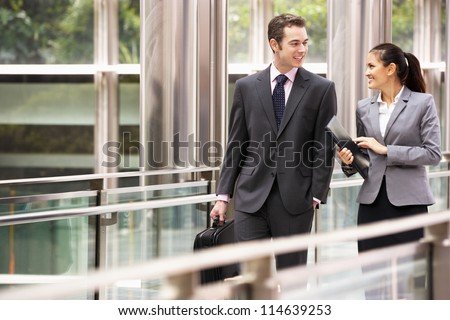 Two Business Colleagues Having Discussion Whilst Walking Outside Office