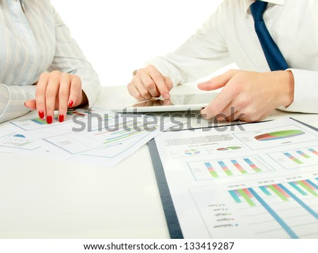 two business partners discussing documents lying