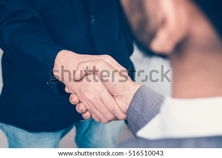 Two business people handshake.