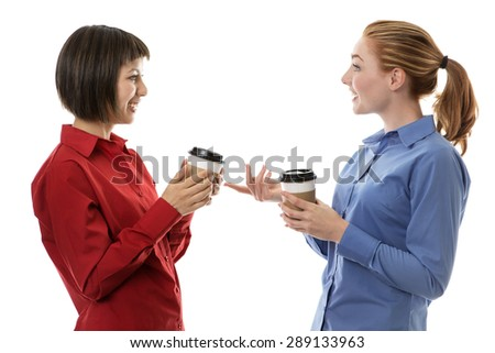 two business woman chatting and gossiping over a coffee