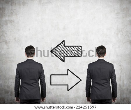 Two businessmen and two arrows 'left or right'. A concept of recruitment business.