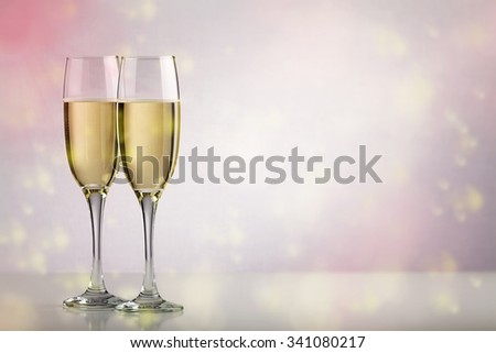 Two champagne glasses over background with copy space