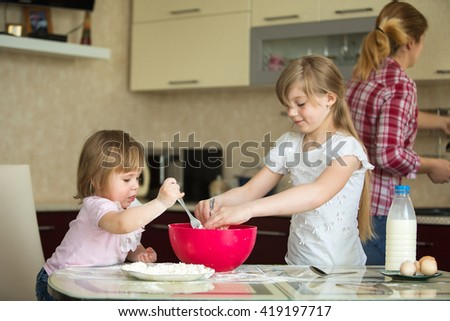 two children in the kitchen, 2 and 7 years