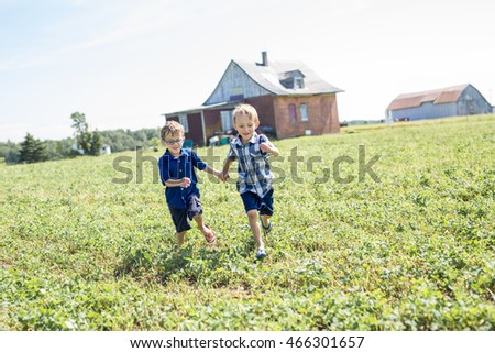 Two Children Together In field