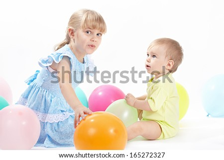 Two children with balloons on a white background