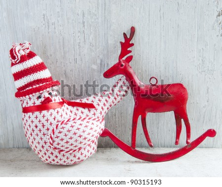 Two Christmas Decoration, A Robin and A Deer, On A Wooden Shelve
