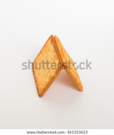 Two crackers in square shape on white background