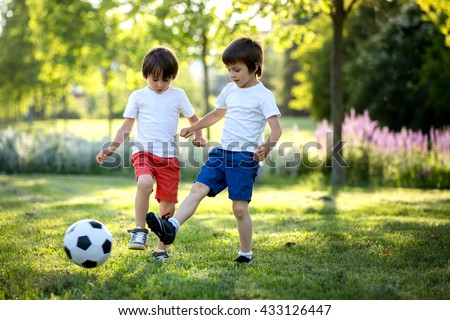 Two Cute Little Kids Playing Football Stock Photo ...
