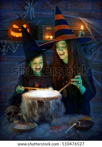 Two cute witches with magical potion