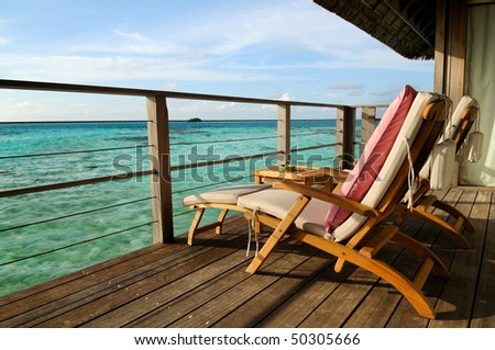 Two deck chairs on a sea view balcony at Maldives.